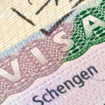 1539613665-bigstock-schengen-visa-in-the-passport-81546971-990x556